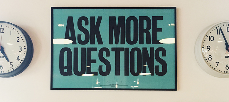 aks questions sign on a wall