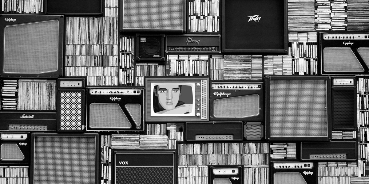 black and white image of old TVs, speakers, and records with a lonely Elvis in the center